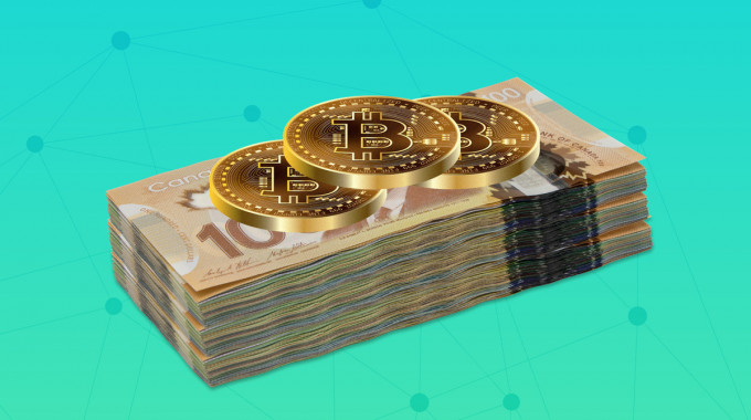 Bitcoin stacked on top of Canadian dollar currency